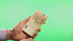 Hands presenting paper money euros Stock Footage