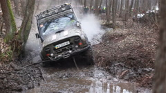 KIEV, UKRAINE - November 28, 2015: SUV UAZ Hunter rides in the forest on a dirt Stock Footage