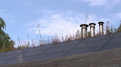 Solar panels on roof of house and chimneys Stock Footage
