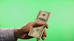Hands counting united states dollars Stock Footage
