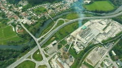 Industrial buildings, highway, railway, river and little village Stock Footage