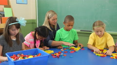 Students in school classroom experiment with shape blocks Stock Footage
