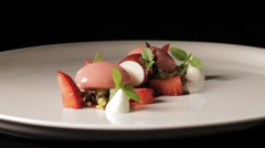 Fine dining dessert turning aroud in black background Stock Footage