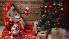 Woman and her dog at xmas wrapping gifts Stock Footage