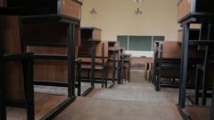 Empty lecture hall at the university. Lecture hall from the aisle between desks. Stock Footage