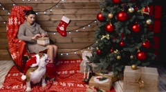 A girl with english bulldog in red hat Stock Footage