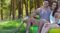 Portrait of couple with kayaks Stock Footage