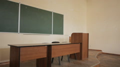 Empty lecture hall at the university. Rostrum, blackboard and teacher's desk. Stock Footage