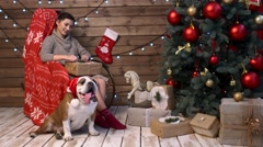 Pretty girl with cute bulldog in red hat Stock Footage