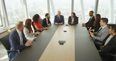 4k, Group of business persons having a meeting around a large table in an office Stock Footage