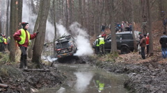 KIEV, UKRAINE - November 28, 2015: SUV Mitsubishi Pajero got stuck in the mud Stock Footage