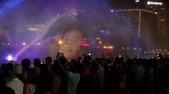 Crowd of People Taking Photo of Fountain Show with Mobile Phone in Night City Stock Footage