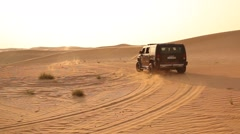 Vehicles Chasing in Desert Stock Footage