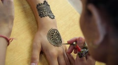 Artist Drawing Henna Tattoo on Woman Hand in India Stock Footage