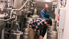 Brewers working at brewery factory Stock Footage