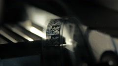 The movement of 16 mm film in film projector, close up Stock Footage