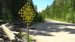 Road closed old road, really closed, debris piled up, pan reveal Stock Footage