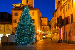 Illuminated Christmas tree in Old City of Alba. Stock Photos