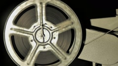 Winding film 16mm on the coil, close up Stock Footage