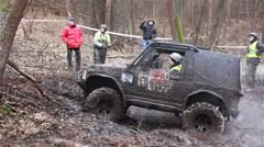 KIEV, UKRAINE - November 28, 2015: SUV Suzuki Jimny starts in the forest Stock Footage
