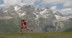 Two Women Running at High Altitude Stock Footage
