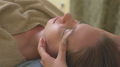 Massagist doing massage a woman face Stock Footage