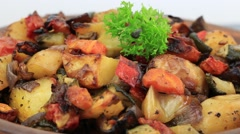 Vegetable stew with tomato, eggplant, zucchini, onion, carrot, pepper and potato Stock Footage