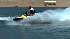 Man riding personal water craft on lake, super slow motion, shot on Phantom Flex Stock Footage