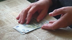 Aged lady counting euro paper money Stock Footage