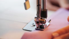 Sewing machine presser foot stitching fabric Stock Footage