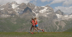 Two Women Running in Slow Motion at High Altitude Stock Footage