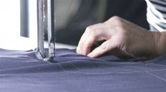 Slowmotion. Blue cut out fabric for clothing in a textile factory Stock Footage