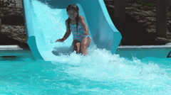 Girl going down waterslide in super slow motion Stock Footage