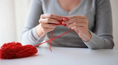 Woman knitting with needles and red yarn Stock Footage