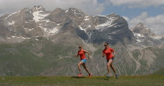 Two Women Running Up a Mountain. Stock Footage