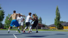 Slow motion shof of friends playing basketball at park Stock Footage