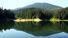 Lake Synevir in Carpathian Mountains in Ukraine Stock Footage