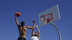 Slam dunk over defender in slow motion Stock Footage