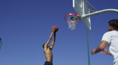 Slow motion basketball slam dunk Stock Footage