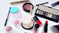 Collection of makeup cosmetics on white background Stock Footage