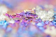 Bornite ore crystallizes mineral its blurred natural background. Stock Photos