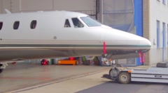Private jet coming out of the hangar, Vaclav Havel Prague airport Stock Footage