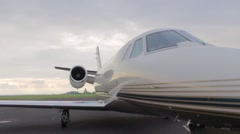 Front side of private jetplane standing at the airport, Vaclav Havel airport Stock Footage