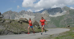 Two Women Run up a Mountain Road. Stock Footage
