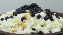 Cottage cheese, sour cream, blueberry and honey in plate. Rotates cottage cheese Stock Footage