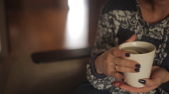 Beautiful girl drinking tea in the restaurant. close-up Stock Footage