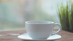 Woman's hand holds a Cup and filling with boiling water from the kettle Stock Footage