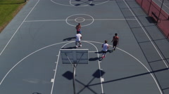 Friends playing basketball at park, high angle shot Stock Footage