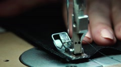 Part of modern sewing machine isolated on black background Stock Footage