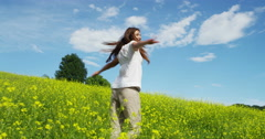 woman surrounded by the more colorful nature turns on itself and breathes Stock Footage